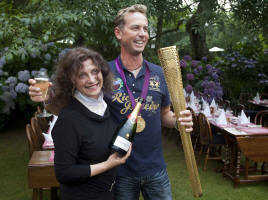 Elizabeth and Karl Hester with Olympic torch